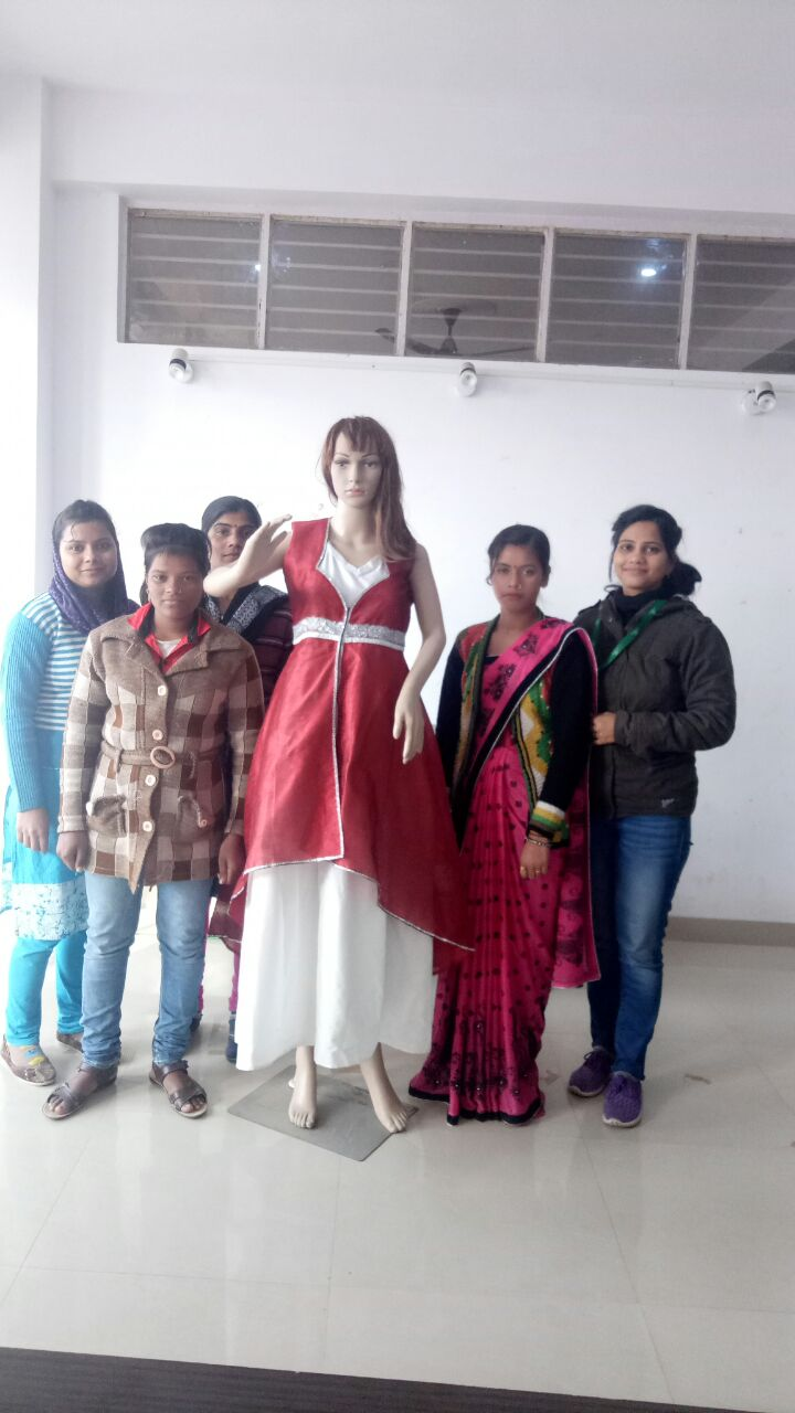 Dress designing and stitching by apparel trainees of Bareilly center's PMKVY