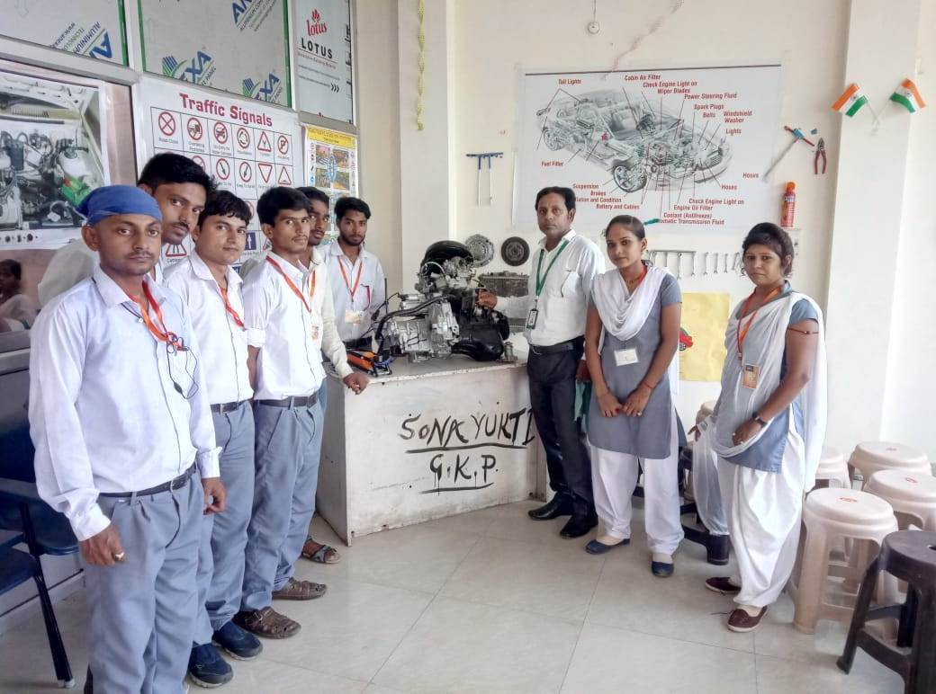 Gorakhpur Center's Power and Automotive course students display their electrical distribution system project.